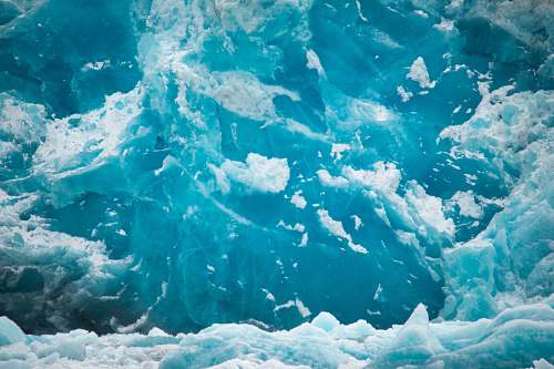 glacier photo of ice and body of water snow