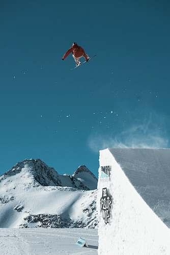 skiing man riding snowboard snow