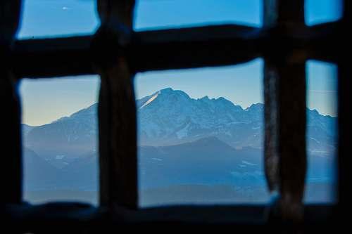 blue photography of mountain range during daytime window