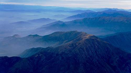 blue aerial photography of mountain range mountain