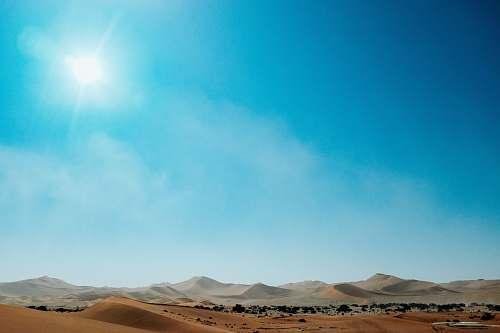 soil desert during daytime sand
