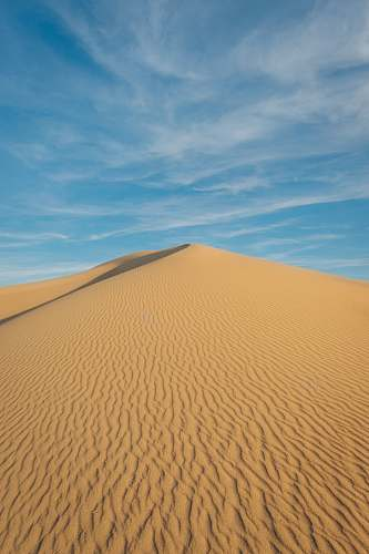 soil desert under clear blue sky sand