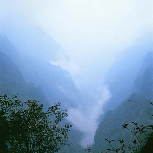 outdoors landscape photo of a foggy valley blue