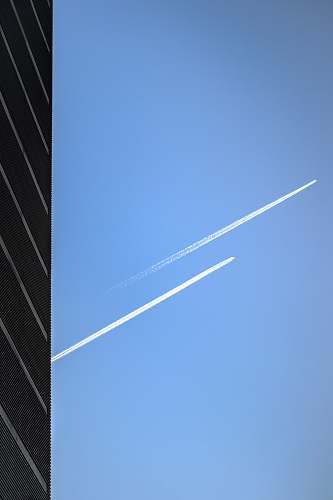 azure sky low-angle photography of two jet planes in the sky outdoors