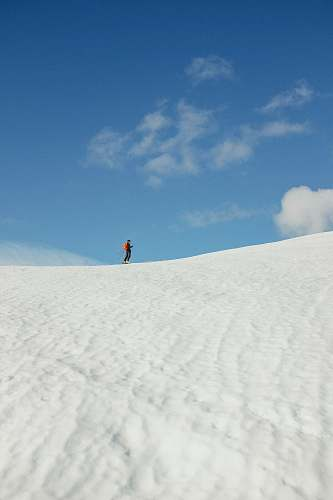 soil person standing on white sand sand