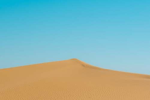 outdoors photo of brown sand dunes soil