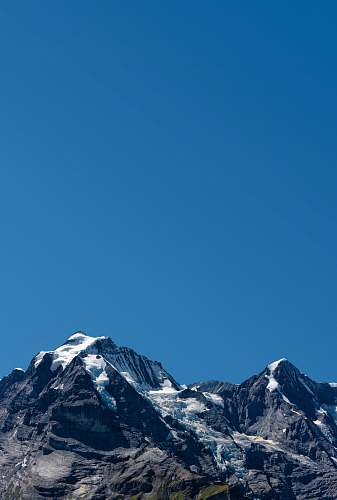 outdoors photography of snow-capped mountain during daytime mountain