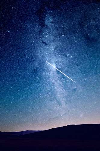 space shooting star under blue sky stars