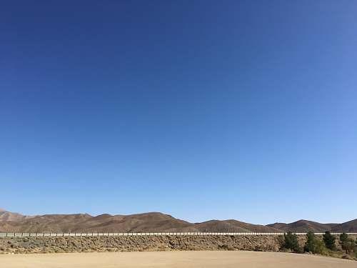 nature grey mountain under blue sky soil
