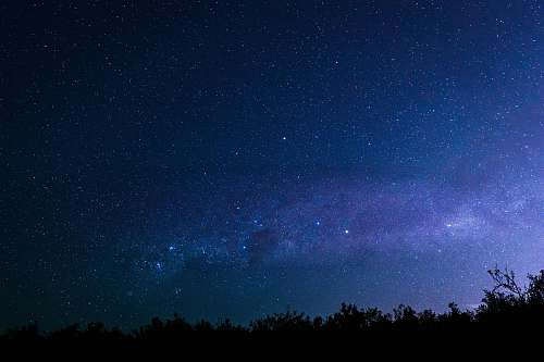blue milky way visible in dark night sky nature