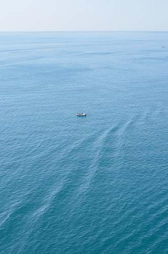 ocean boat on calm body of water water