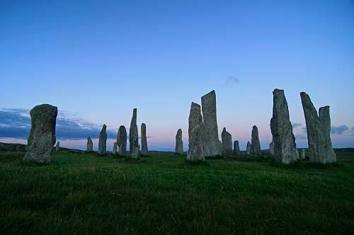 outdoors lined rocks on green grass field landmark rock