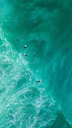 nature aerial photography of surfers on sea outdoors