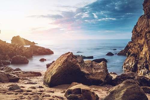 nature huge rock near beach beach