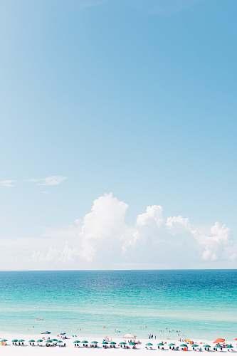 ocean landscape photography of white sand beach beach