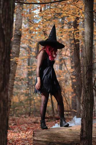 clothing witch standing under trees person