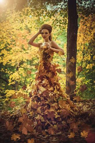 clothing woman standing surrounded by leaves fashion