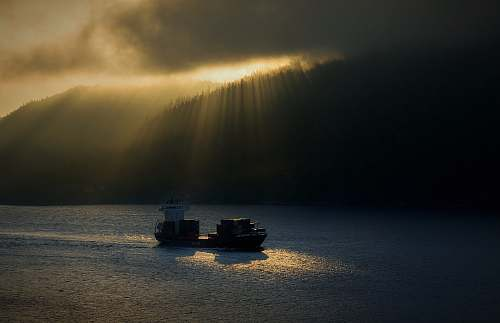 drøbaksundet two ships on body of water under cloudy skies during golden hour norway