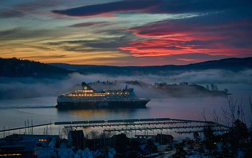 vehicle white cruise ship on body of water during dusk transportation