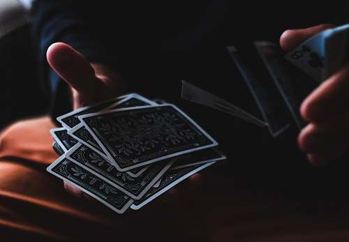 photo game person playing with cards hand free for commercial use images
