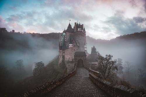 building closeup photo of castle with mist architecture