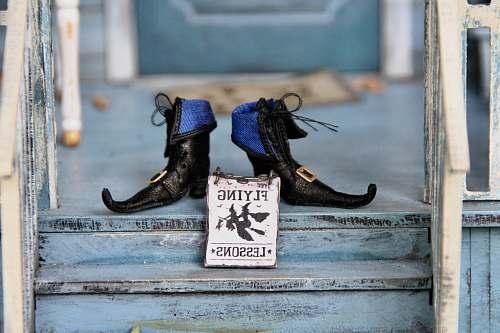 apparel pair of black shoes footwear