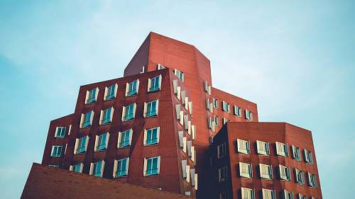 housing low angle photo of concrete building building