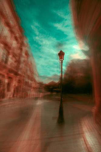 layers black street post lamp beside wall magician