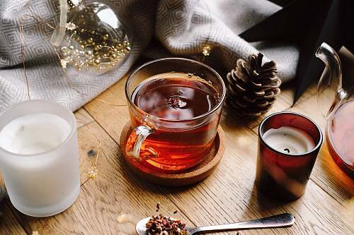 milk tea cup beside brown pine cone beverage