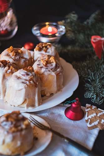 candle plate of cinnamon rolls beside a lighted tealight dessert