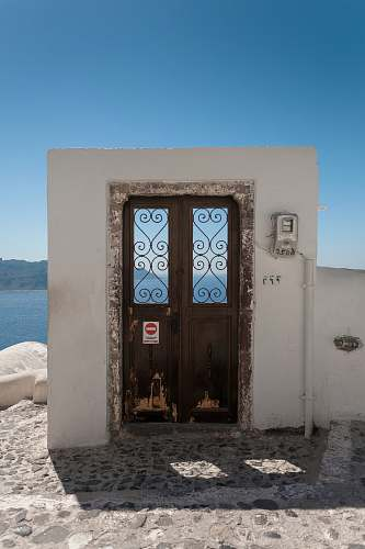 architecture closed brown door facing body of water thera