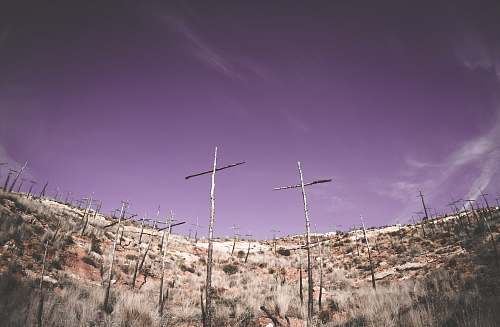 antenna low-angle photography gray wooden cross on hilltop electrical device