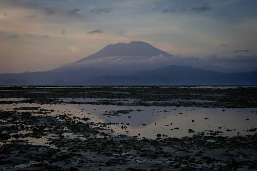 indonesia white cloud covering mountain mount agung