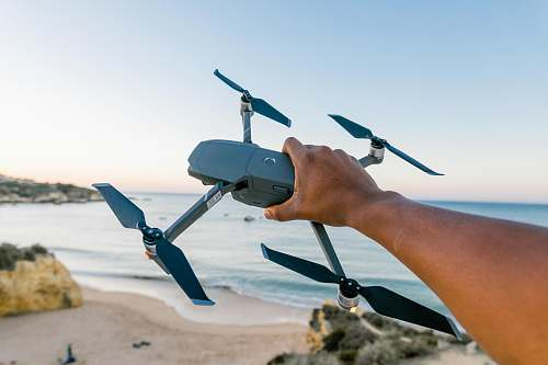 person black quadcopter drone outdoors