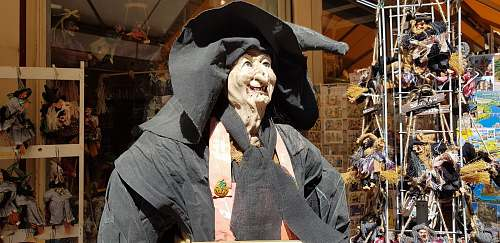 apparel witch mascot near store clothing