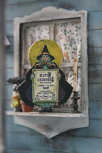 person witch services signage on window shelf symbol