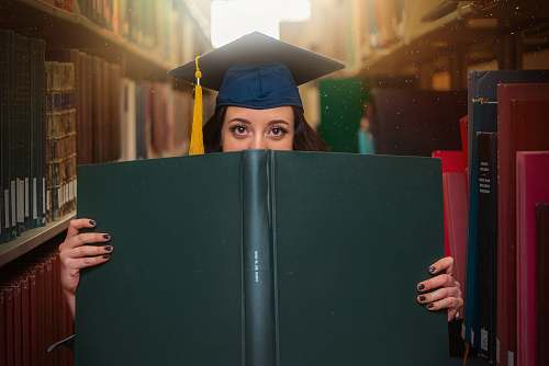 person woman holding book graduation