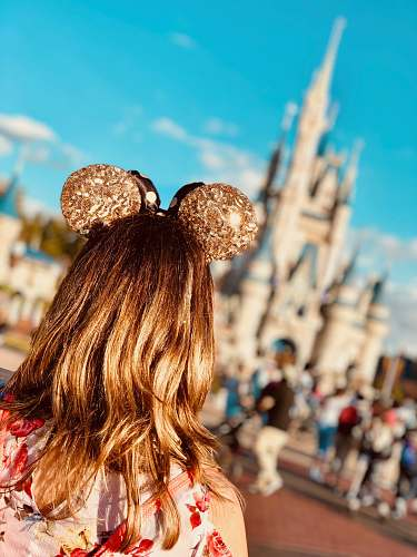 person woman wearing golden Mickey Ears at Disneyland hair