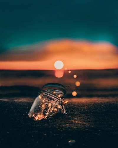 toronto clear glass jar on sand fairy light