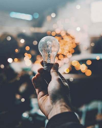 idea person holding light bulb bulb