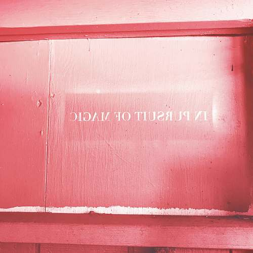 pink red wooden panel board quote