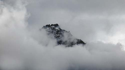 clouds Snowy mountain summer peeks through clouds in Franz Josef Glacier outdoors