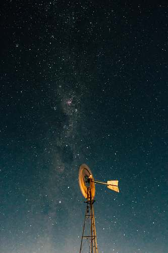 australia windmill under blue sky during nighttime windmill