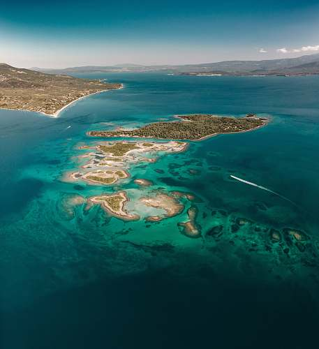 outdoors aerial photography of island near other islands landscape