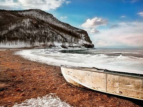 boat beige boat on shore landscape