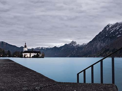 mountain landscape photograph of lighthouse alps