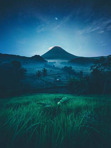 bali mountain near green trees at night indonesia