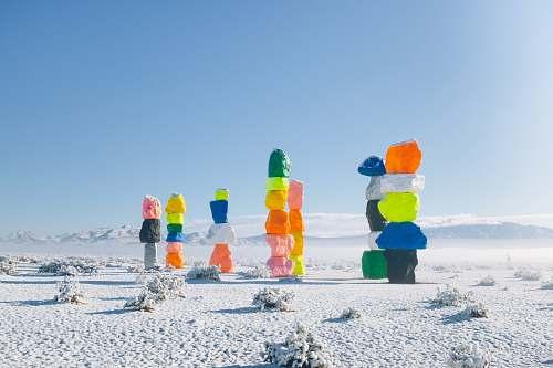 outdoors multi-colored rocks on snow snow