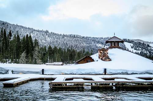 outdoors snow covered dock on the water water