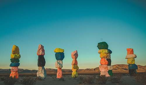 nature assorted-colored stacked stones photo seven magic mountains